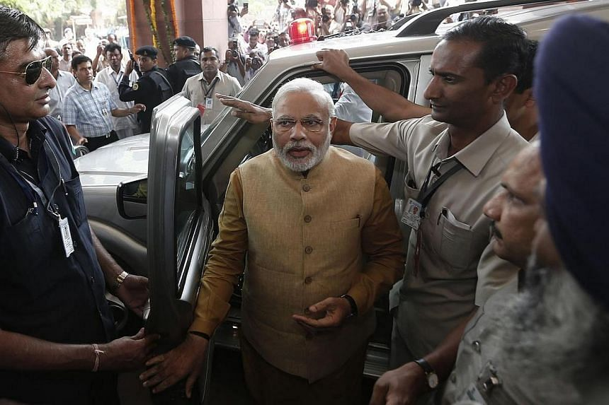 Hindu nationalist Narendra Modi, the prime ministerial candidate for India's Bharatiya Janata Party (BJP), arrives to attend the BJP parliamentary party meeting at parliament house in New Delhi on May 20, 2014. India's Prime Minister-elect Naren