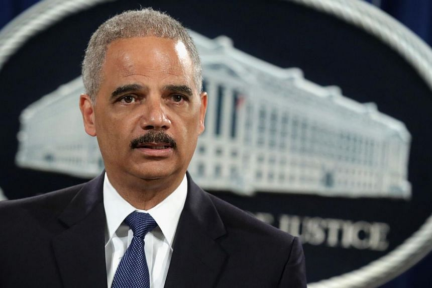 US Attorney General Eric Holder speaks as he announces indictments against Chinese military hackers on cyber-espionage May 19, 2014 at the Department of Justice in Washington, DC. -- PHOTO: AFP