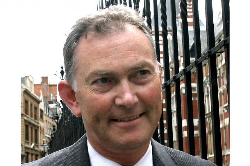 Premier League's Chief Executive Richard Scudamore (above) leaving London's High Court on July 13, 2007. Mr Scudamore spoke of his sincere contrition after it was announced on Monday he wouldn't lose his job for sending sexist emails. -- FILE PHOTO