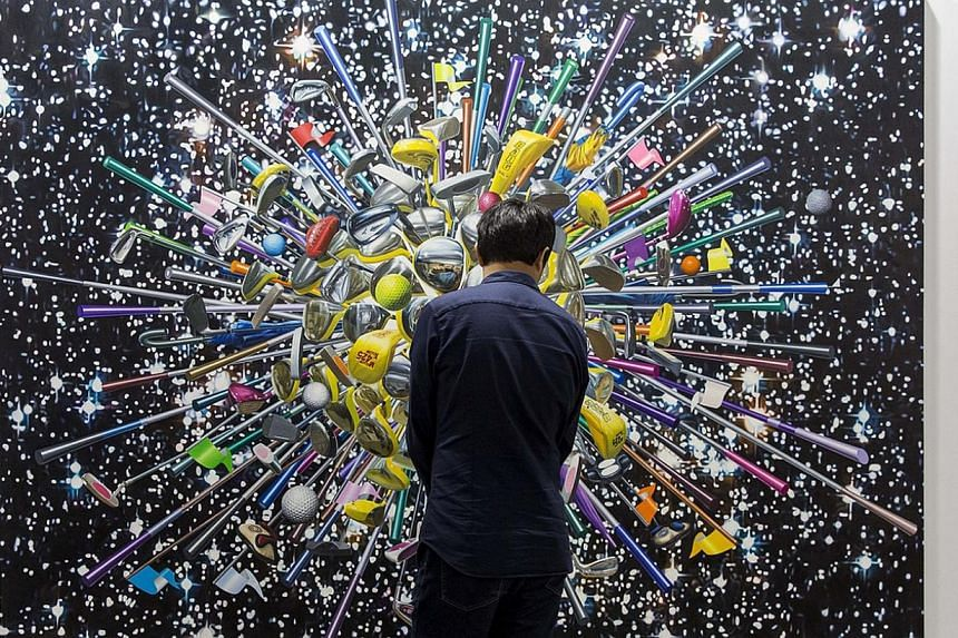 More than 80 citizens and visa applicants were recruited for a yet-to- be-formed utopian state, in an installation (above) by Chinese artist Sun Xun that is a collaboration between Singapore's STPI and China's ShanghART gallery. Varied works: Chinese