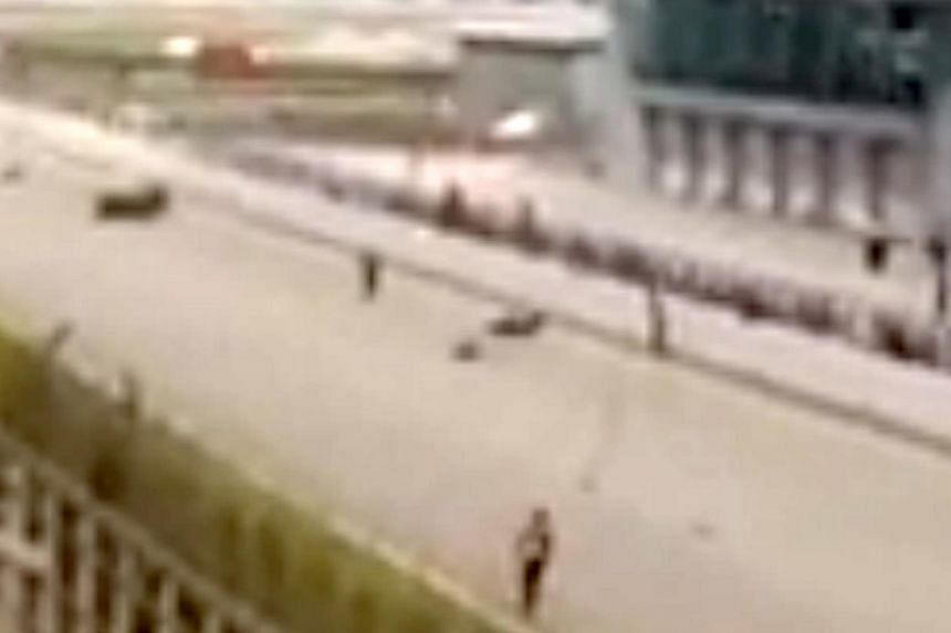 The accident scene on Sunday at Malaysia's Sepang track. Racing veteran Milton Poh hit another bike that veered into his lane. -- PHOTO: SCREEN GRAB FROM YOUTUBE