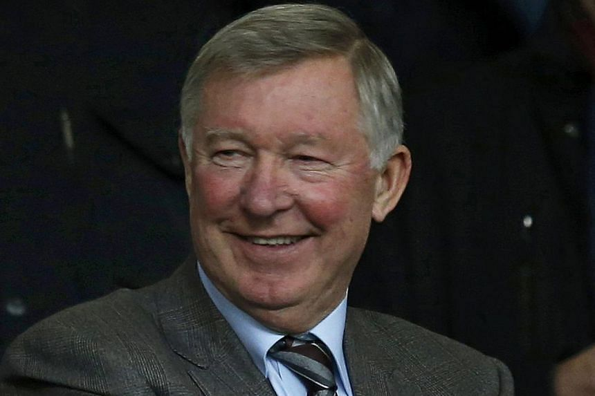 Former Manchester United manager Alex Ferguson takes his seat in the stand before their English Premier League soccer match against Manchester City at Old Trafford in Manchester, northern England on March 25, 2014. Sir Ferguson saluted Ryan Giggs' fa