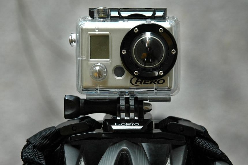 GoPro HD Helmet Hero video camera. GoPro, which makes wearable sports cameras and accessories, filed with US regulators on Monday to raise up to US$100 million (S$125 million) in an initial public offering of common stock. -- FILE PHOTO: DANSON CHEON