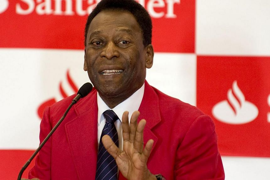 """Brazilian former football star Edson Arantes do Nascimento, aka """"Pele"""", speaks during a press conference at the Universidad Anahuac in Huixquilucan, State of Mexico, Mexico on May 19, 2014. -- PHOTO: AFP"""