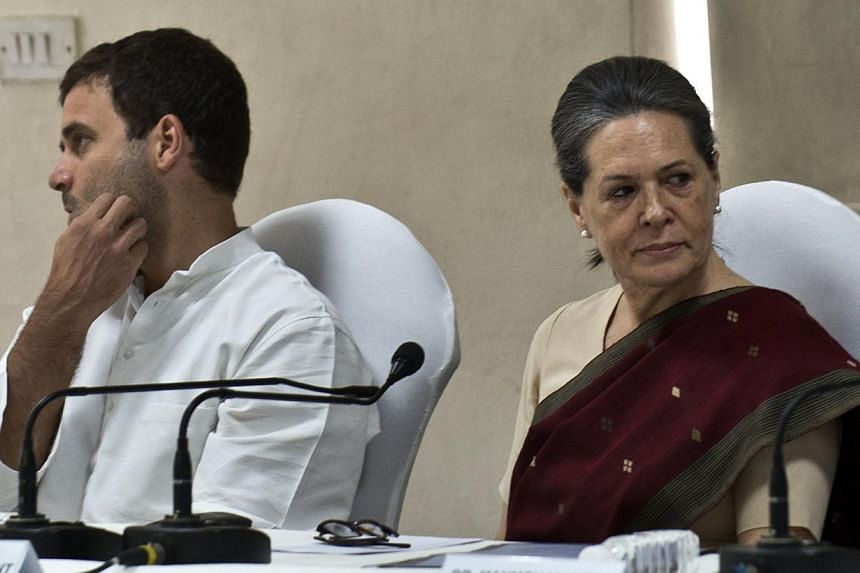 Congress party President Sonia Gandhi (right) and Vice-President Rahul Gandhi attend the Congress Working Committee (CWC) meeting in New Delhi on May 19, 2014. Sonia and Rahul Gandhi, leaders of India's defeated Congress party, offered to resign afte
