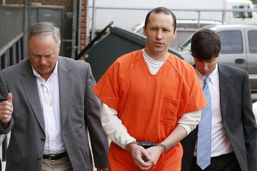James Everett Dutschke (centre), flanked by United States (US) Marshals, arrives for a sentencing hearing at the US Federal Building in Aberdeen, Mississippi on May 13, 2014. -- FILE PHOTO: REUTERS