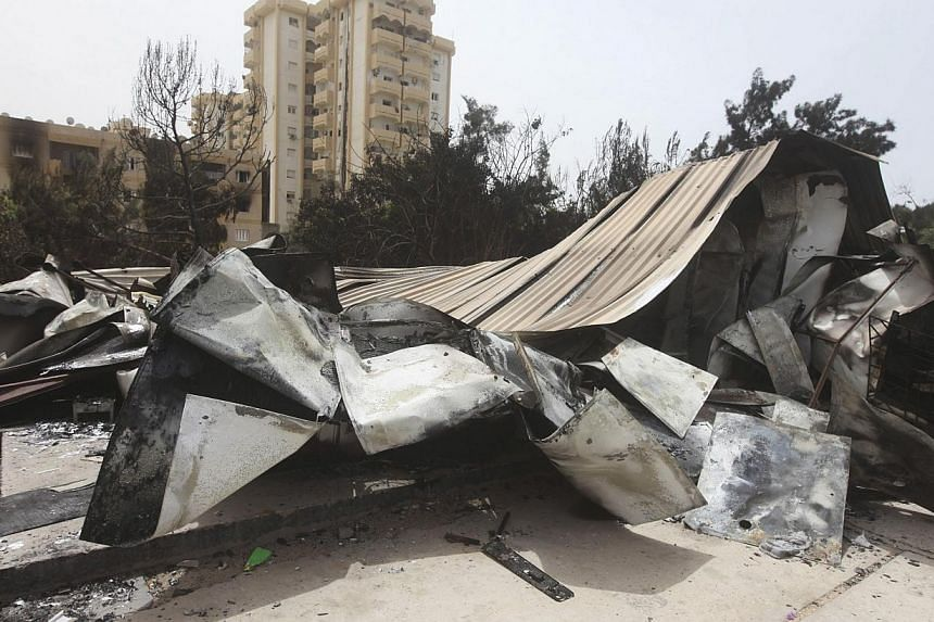 A view of damage caused by Sunday's clashes in Tripoli on May 19, 2014. Washington is closely monitoring an upsurge of violence in Libya, but has not decided yet whether to order the closure of its embassy in Tripoli, a US official said on Monday. --