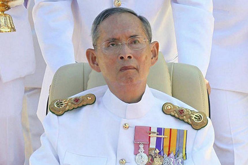 Thai King Bhumibol Adulyadej sits in a wheelchair during the 64th anniversary of Coronation Day at the Klai Kangwon Palace in Hua Hin, south-west of Bangkok, Thailand, on May 5, 2014. -- FILE PHOTO: EPA