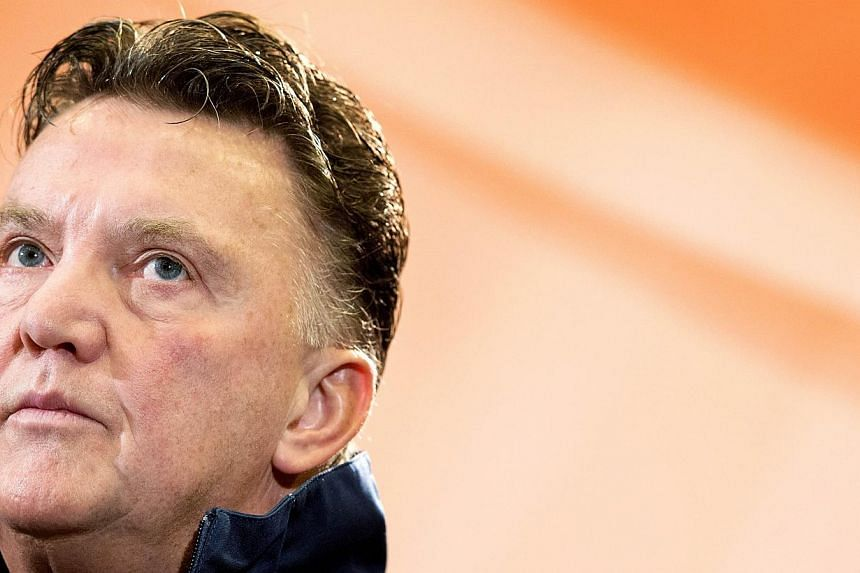 Dutch national football team's coach Louis van Gaal attends a press conference in Noordwijk, on the eve of the Netherlands' international football match against Colombia on Nov 18, 2013. Louis van Gaal promised to make history and return Manchester U