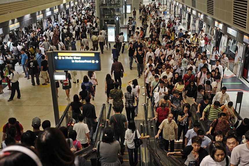 Despite incentives, the moderate success gained in moving MRT commuters off the morning rush hour, so as to relieve congestion, makes it plain that a solution does not come easy. -- ST FILE PHOTO: JOSEPH NAIR