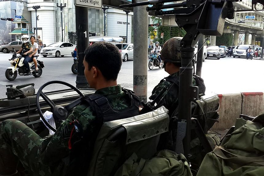 An army jeep at the upscale Rachaprasong intersection in downtown Bangkok. It's business as usual for residents. -- ST PHOTO: NIRMAL GHOSH