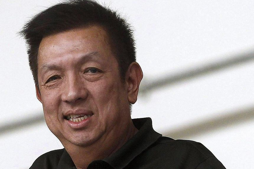Singaporean billionaire Peter Lim during an Atletico Madrid exhibition soccer match at Jalan Besar Stadium in Singapore on May 21, 2013. -- FILE PHOTO: EPA