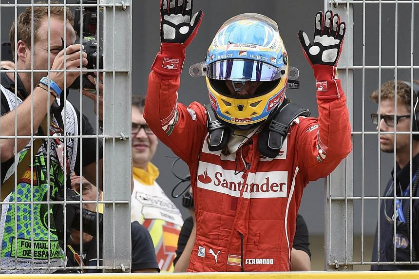 Ferrari's Spanish driver Fernando Alonso reacts at the end of the Spanish Formula One Grand Prix at the Circuit de Catalunya, in Montmelo on the outskirts of Barcelona, on May 11, 2014. -- FILE PHOTO : AFP