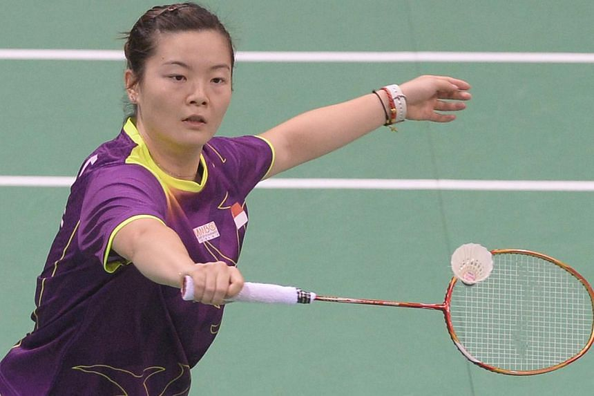 Fu Mingtian of Singapore plays a return to Maria Febe Kusumastuti of Indonesia during their Uber Cup badminton match at Siri Fort Stadium in New Delhi on May 20, 2014. -- PHOTO : AFP