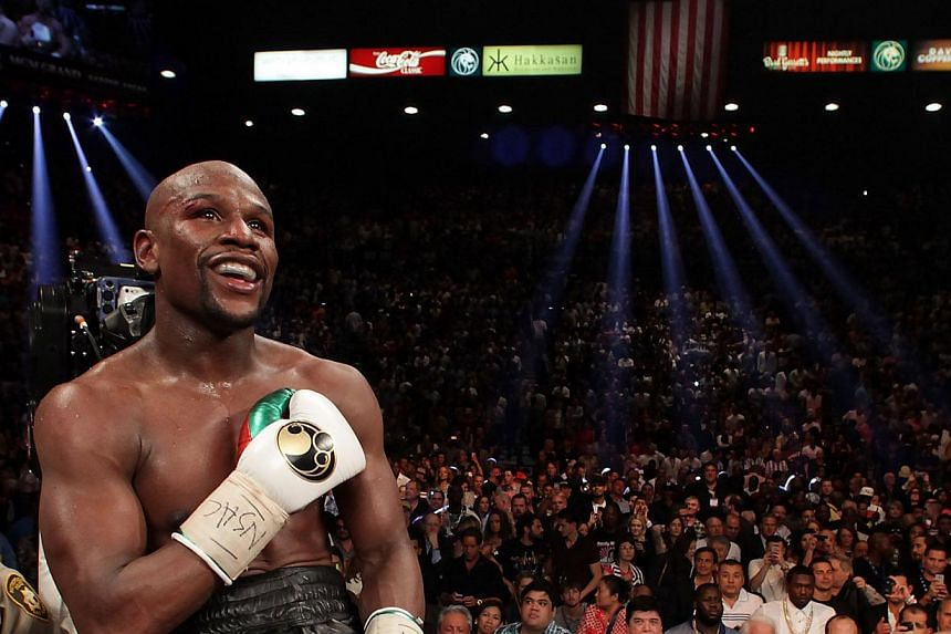 Floyd Mayweather Jr of the US celebrates his win over Marcos Maidana of Argentina on May 3, 2014 at The MGM Grand, Las Vegas.  -- FILE PHOTO : AFP
