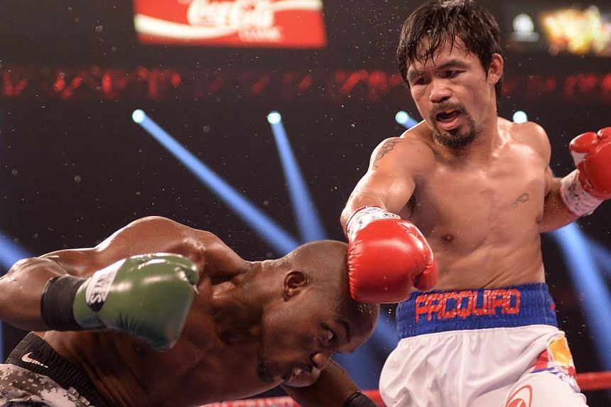 Timothy Bradley of US defends against Manny Pacquiao of Philippines (right) during their WBO World Welterweight Championship title match at the MGM Grand Arena in Las Vegas on April 12, 2014. -- FILE PHOTO : AFP