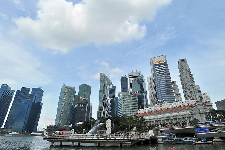 Singapore's economy grew 4.9 per cent in the first three months of the year over a year ago, lower than the 5.1 per cent previously estimated, the Ministry of Trade and Industry (MTI) said on Tuesday, May 20, 2014. -- ST FILE PHOTO: LIM YAOHUI