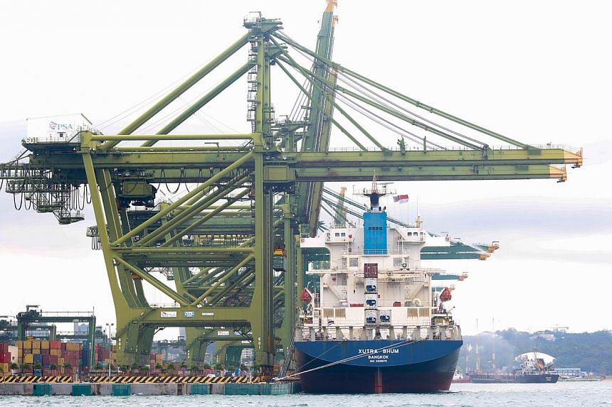 The port at Pasir Panjang. Exports from Singapore slipped 1 per cent in the first quarter of this year compared with the same period last year, according to data released by trade agency IE Singapore on Tuesday, May 20, 2014. -- ST FILE PHOTO: ONG WE
