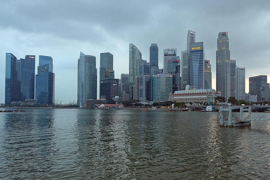 Singapore's economy grew 4.9 per cent in the first three months of the year over a year ago, the Ministry of Trade and Industry (MTI) said on Tuesday. -- ST FILE PHOTO: DESMOND WEE