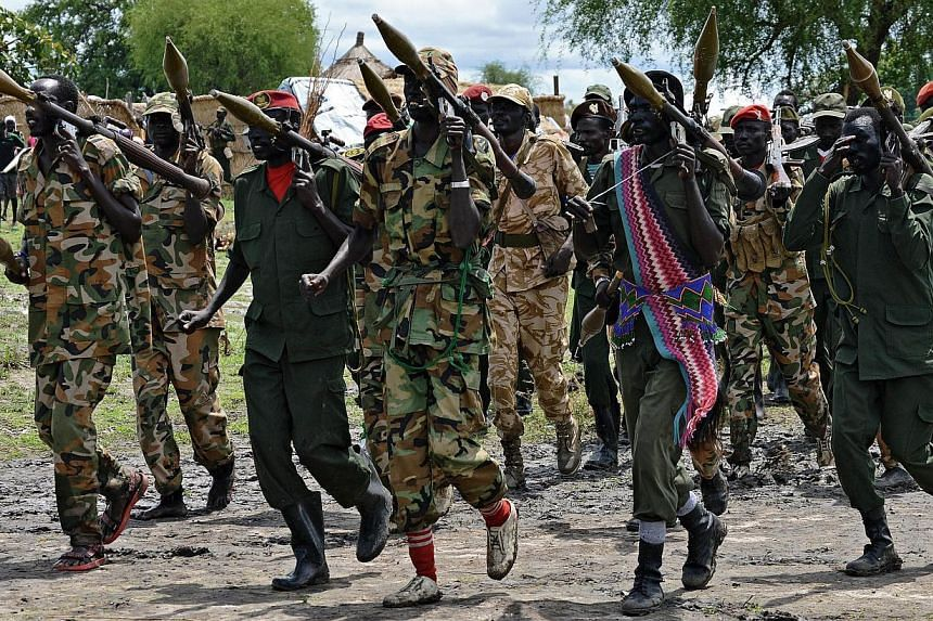 Members of the South Sudan Democratic Movement/Army (SSDM/A) faction march in Gumuruk on May 13, 2014. -- FILE PHOTO: AFP