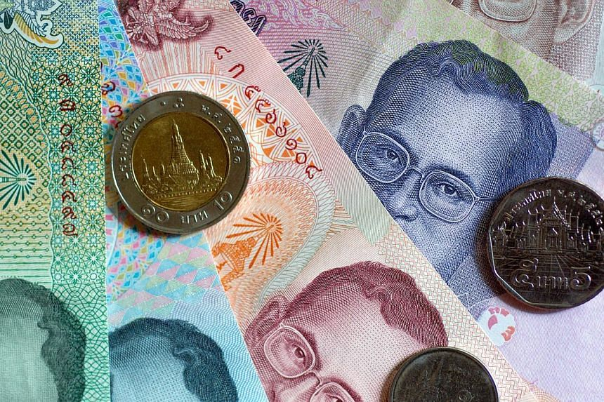 Thailand's baht fell against the dollar in early trade on May 20, 2014 after the imposition of martial law by the army, but it steadied later and dealers suspected that was due to intervention by the central bank. -- FILE PHOTO: BLOOMBERG