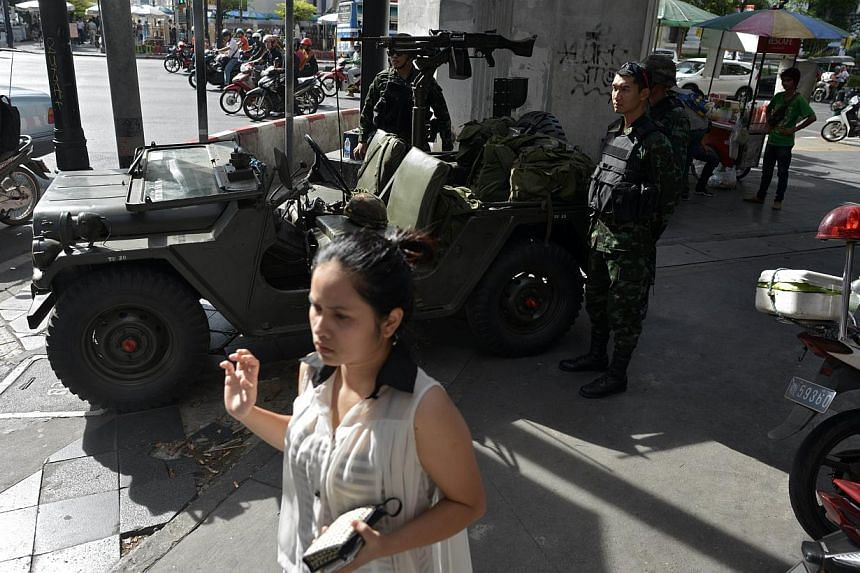 Thai army soldiers securing Ratchaprasong intersection in Bangkok on May 20, 2014. -- PHOTO: AFP