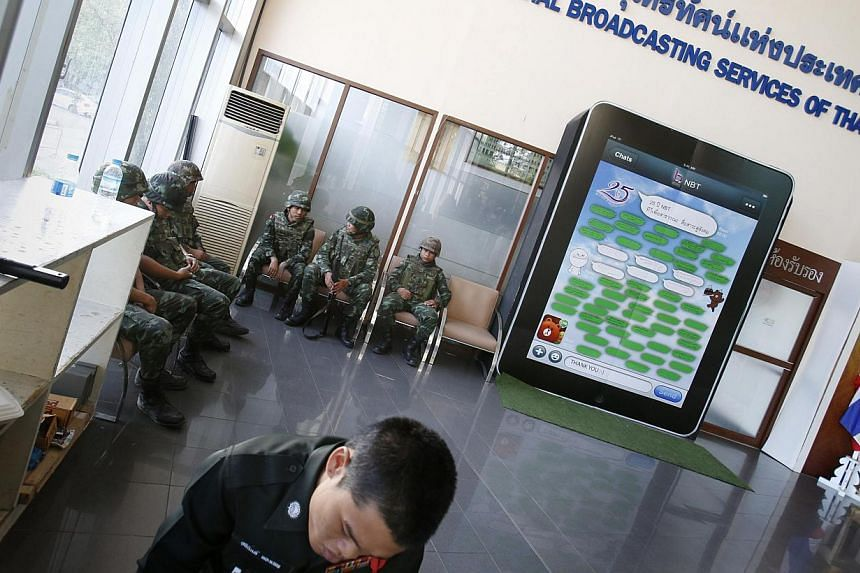 Thai soldiers occupy the foyer of the National Broadcasting Services of Thailand television station in Bangkok on May 20, 2014. -- PHOTO: REUTERS