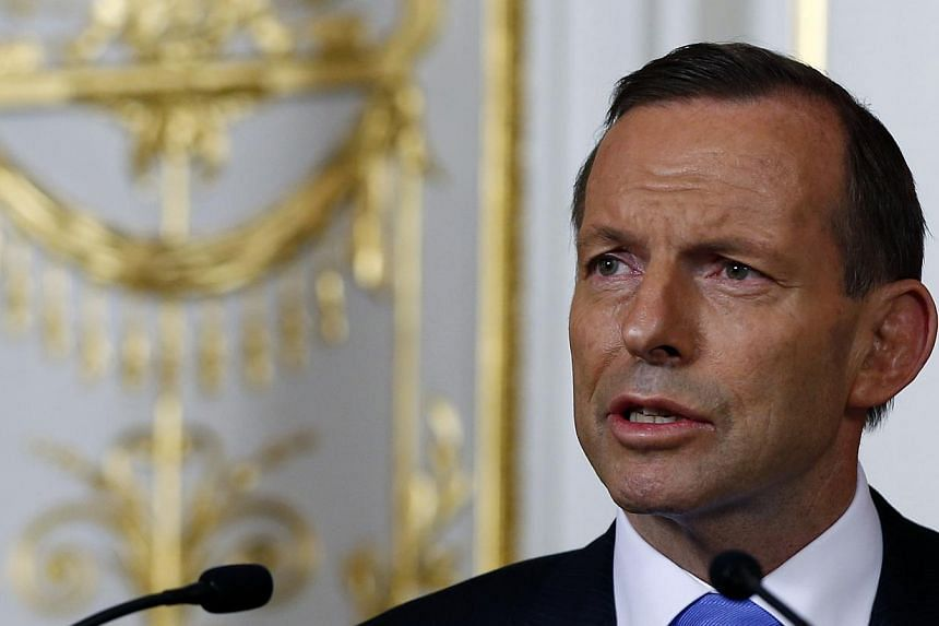 Australian Prime Minister Tony Abbott warned Tuesday, May 20, 2014, the country could lose its coveted AAA credit rating if the tough measures in his government's maiden budget are not adopted. -- FILE PHOTO: REUTERS