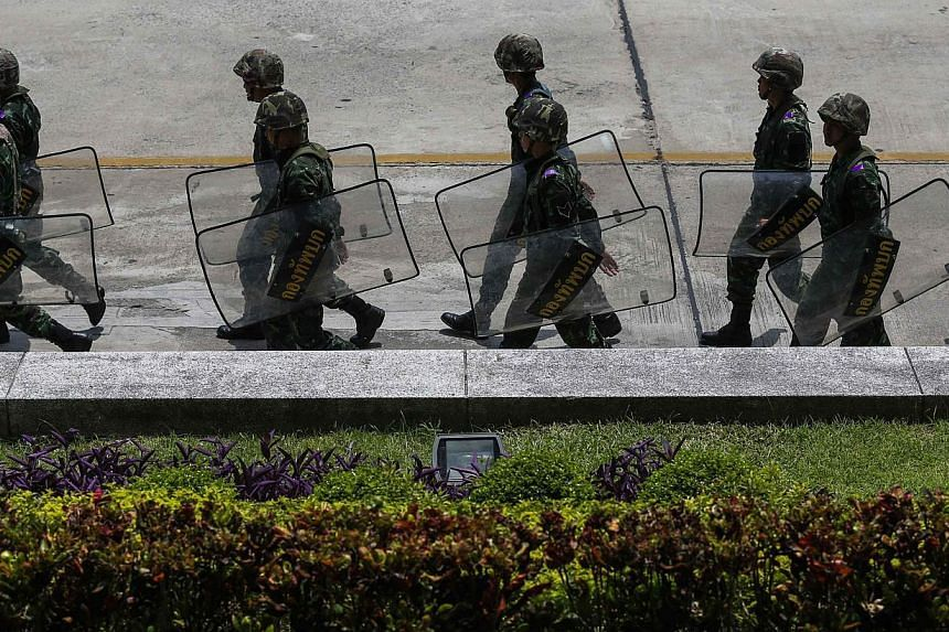 Thai soldiers walk inside a compound of the Army Club after the army declared martial law nationwide to restore order, in Bangkok on May 20, 2014. -- PHOTO: REUTERS