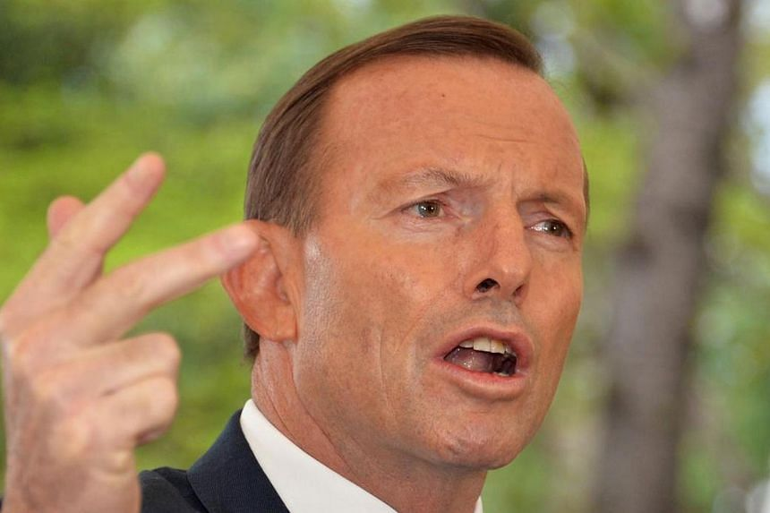 Australian Prime Minister Tony Abbott came under fire on Wednesday, May 21, 2014, for winking when he took a call on air from a distressed pensioner who said she worked on a sex phone line to pay the bills. -- PHOTO: AFP