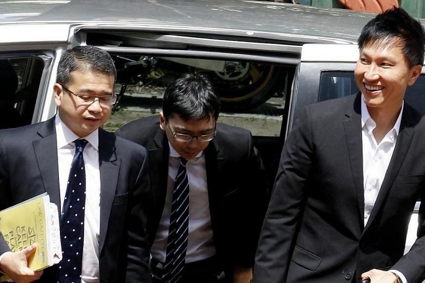 City Harvest Church founder Kong Hee (right) arriving at court with lawyer Edwin Tong (left) and an unidentified lawyer on May 5, 2014. The City Harvest Church trial resumed briefly on May 21 as one of the defence lawyers asked the court to refer two