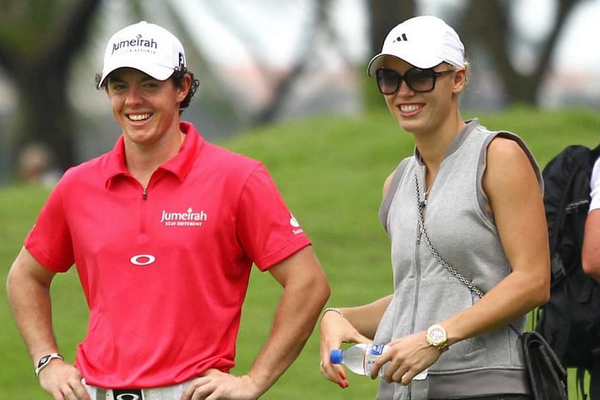 Rory McIlroy, accompanied by his girlfriend and tennis player Caroline Wozniacki, at the Serapong course in Sentosa Golf Club on Nov 8, 2012, Day 1 of the Barclays Singapore Open.-- ST PHOTO: BENJAMIN SEETOR