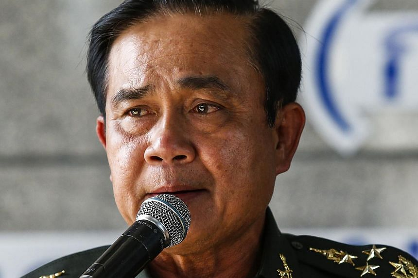 Thai Army chief General Prayuth Chan-ocha speaks during a news conference at The Army Club after the army declared martial law nationwide to restore order, in Bangkok on May 20, 2014. -- PHOTO: REUTERS