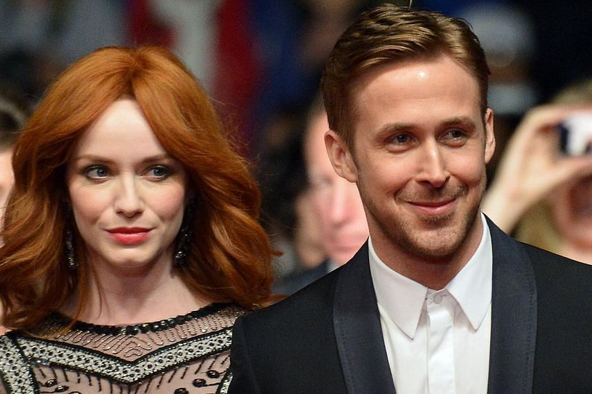Canadian actor Ryan Gosling (R) and US actress Christina Hendricks arrive for the screening of the film Lost River at the 67th edition of the Cannes Film Festival in Cannes, southern France, on May 20, 2014. -- PHOTO: AFP