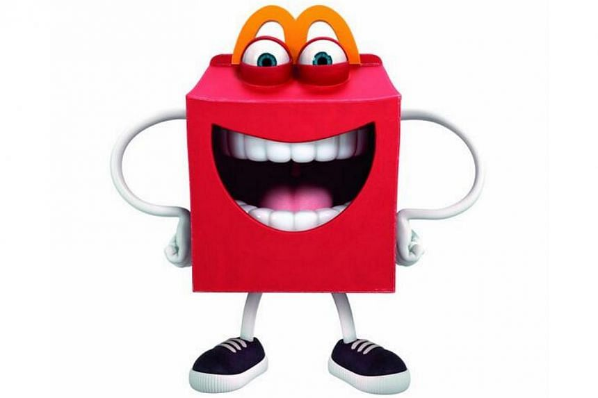 "McDonald's restaurant chain says its new ""Happy"" mascot will bring ""fun and excitement"" to its children's meals, but social media contend the toothy, red box-shaped character will have the opposite effect. -- SCREENGRAB: MCDONALD / TWITTER"