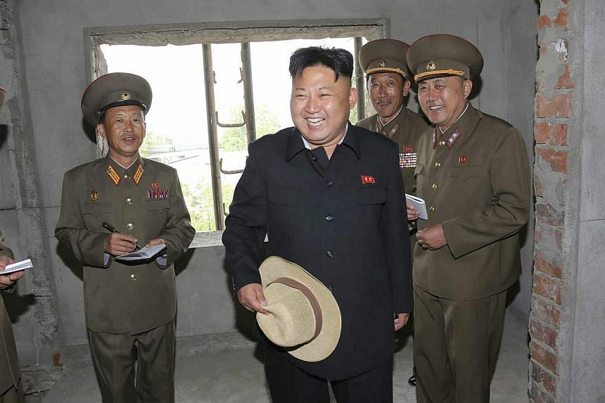 An undated picture released by the North Korean Central News Agency (KCNA) on May 21 2014 shows North Korean leader Kim Jong Un (centre) touring an apartment construction site in Pyongyang, North Korea. North Korean leader Kim Jung Un has sought to r