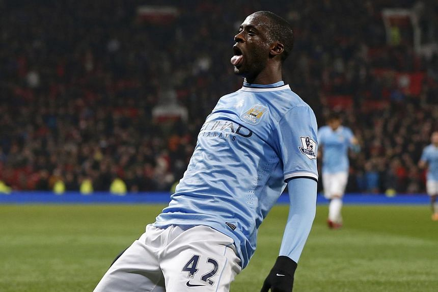 Manchester City's Yaya Toure celebrates his goal against Manchester United during their English Premier League soccer match at Old Trafford in Manchester, northern England on March 25, 2014.Yaya Toure's future as a Manchester City player is i