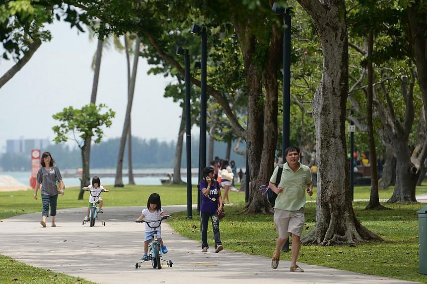 Parents spending time with their children at East Coast Park. -- ST PHOTO: JAMIE KOH