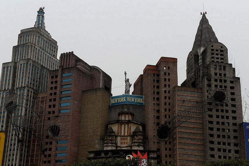 This photo taken on on February 21, 2014 shows a copy of the New York skyline at a theme park in Chongqing. Already renowned for copying Western goods from trainers to champagne, China is building up its replica reputation with a miniature Mount Rush
