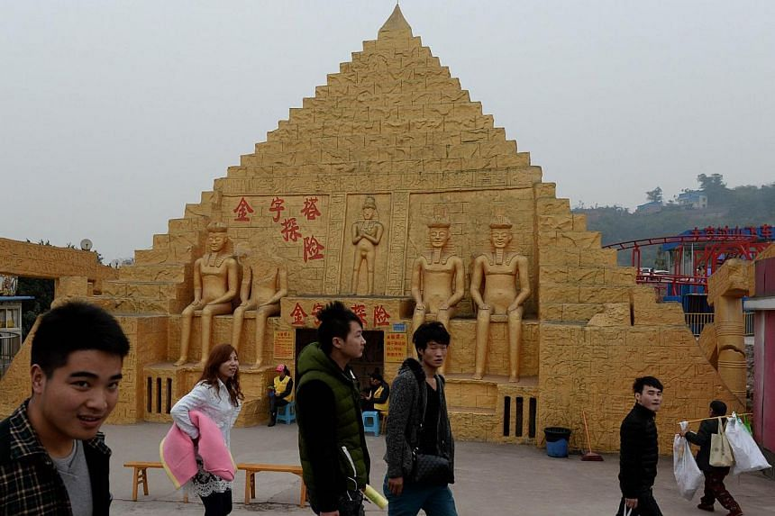 This photo taken on on February 21, 2014 shows a copy of a pyramid at a theme park in Chongqing. Already renowned for copying Western goods from trainers to champagne, China is building up its replica reputation with a miniature Mount Rushmore, Eiffe