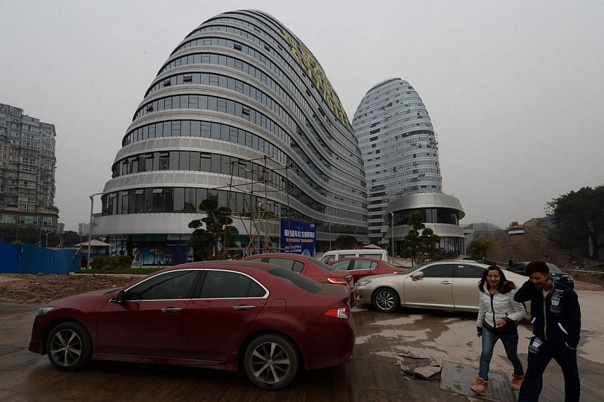 This photo taken on on February 21, 2014 shows a new building that has a striking resemblance to a design of a Beijing development by star British architect Zaha Hadid, in Chongqing. Already renowned for copying Western goods from trainers to champag