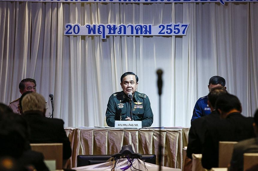 Thai Army chief General Prayuth Chan-ocha speaks during meeting with high ranking officials at The Army Club after the army declared martial law nationwide to restore order, in Bangkok. -- PHOTO: REUTERS