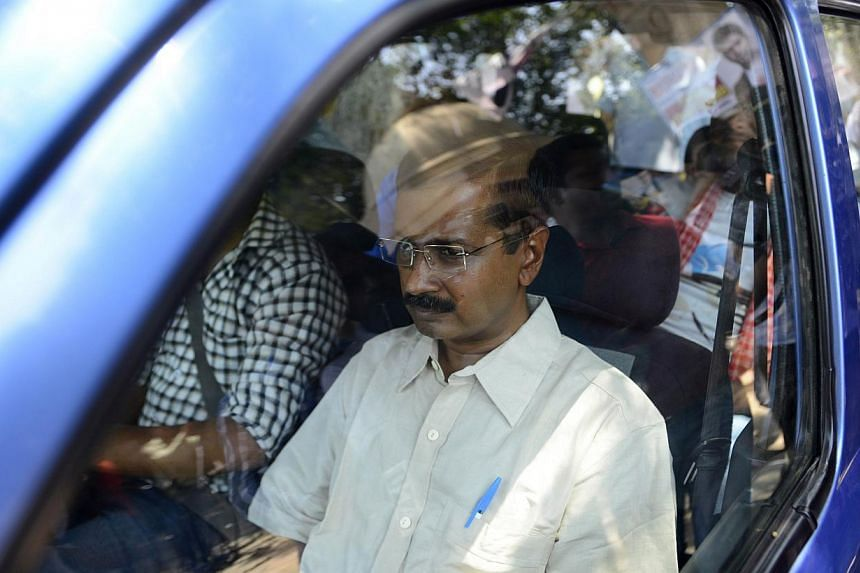 Indian Aam Admi Party leader Arvind Kejriwal is seen outside a courthouse in New Delhi on May 21, 2014. The anti-corruption campaigner was sent to jail for refusing to pay a bond, just hours after declaring he was ready to fight fresh elections in De