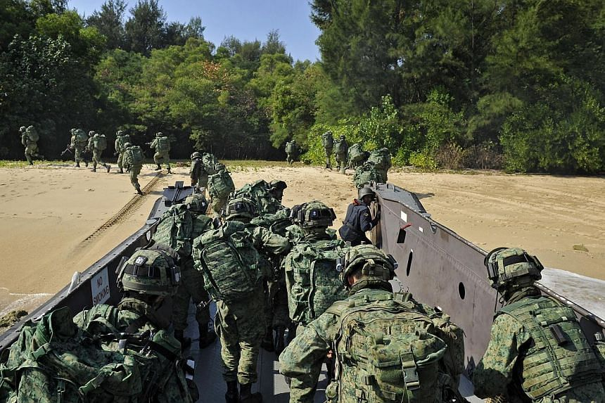 Servicemen from the Singapore Armed Forces (SAF) participating in a military exercise on Pulau Sudong on Aug 2, 2011, which was part of a two-week-long drill to test the battle-readiness of Singapore's air force, navy and army units. -- PHOTO: ST F