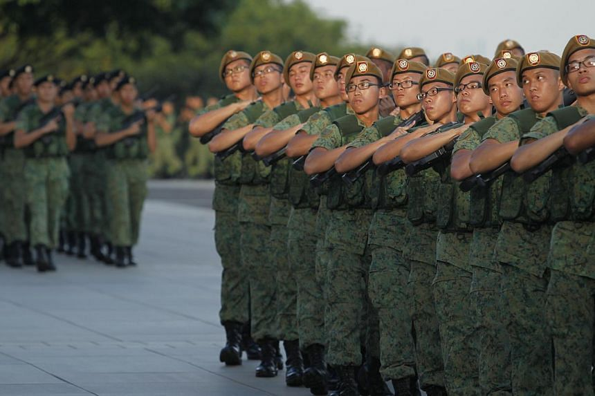 Members of the Singapore Armed Forces during the march pass at the SAF Day Parade held at Safti Military Institute on July 1, 2013. -- PHOTO: ST FILE