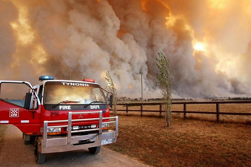Country Fire Authority (CFA) staff member monitoring a giant fire raging in the Bunyip State Park near Labertouche, some 125km west of Melbourne, during Victoria's deadly Black Saturday fires on Feb 7, 2009.Australian researchers are working on