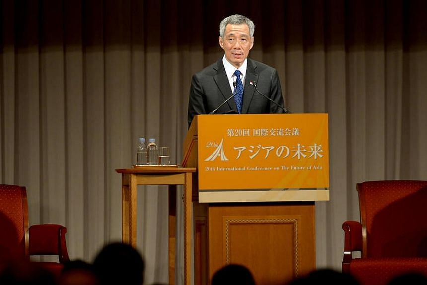 Singapore Prime Minister Lee Hsien Loong delivers a speech during the 20th International Conference on the Future of Asia in Tokyo on May 22, 2014. -- ST PHOTO:JAMIE KOH