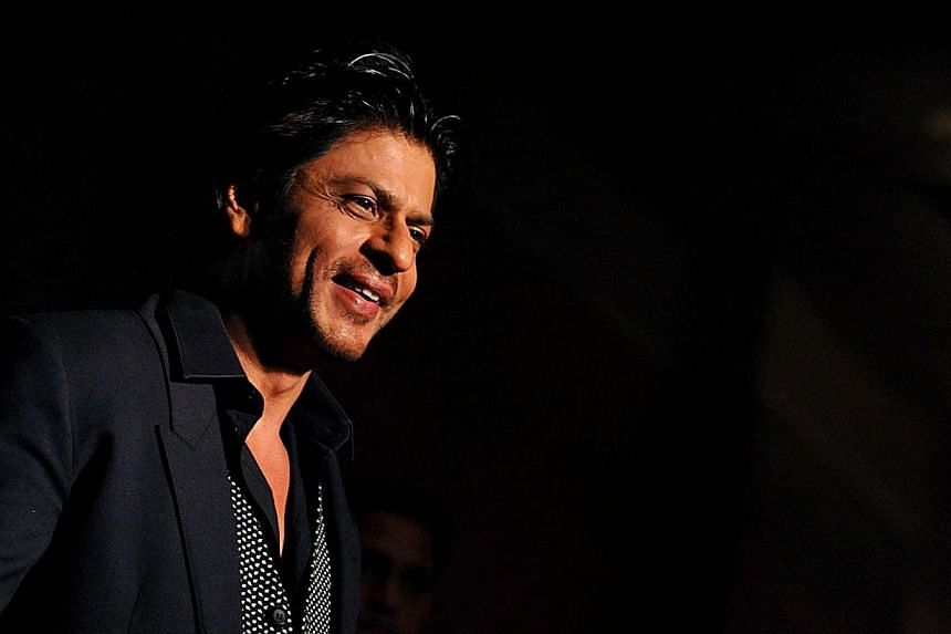 Indian Bollywood actor Shah Rukh Khan attends the Colors IAA Awards and after party in Mumbai on March 1, 2014.Khan is the world's second-richest actor with a fortune of US$600 million (S$752 million), according to a survey. -- PHOTO: AFP