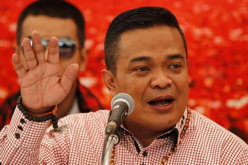 "Pro-government ""red shirt"" protest leader Jatuporn Prompan during a conference at his encampment in Nakhon Pathom province on the outskirts of Bangkok on May 22, 2014. -- PHOTO: REUTERS"