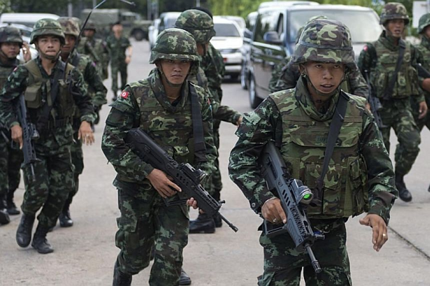 Thai soldiers patrol after army chief General Prayut Chan-O-Cha met with anti-government and pro-government leaders at the Army Club in Bangkok on May 22, 2014. -- PHOTO: AFP